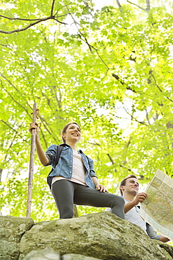 Couple hiking with map in forest, USA, New Jersey, Mendham