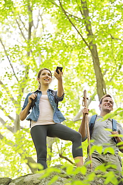 Couple hiking with GPS in forest, USA, New Jersey, Mendham