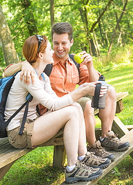 Couple resting during hiking in forest, USA, New Jersey, Mendham