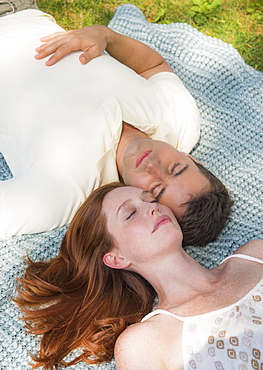 Portrait of couple lying on blanket, USA, New Jersey, Mendham