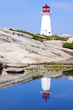 Peggy's Point Lighthouse reflecting in water, Nova Scotia, Canada
