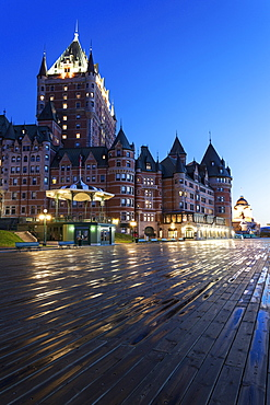 Illuminated Chateau Frontenac seen from boardwalk, Quebec, Canada