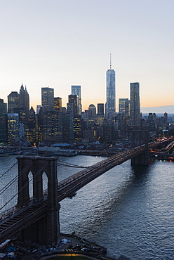 Lower Manhattan, View of Brooklyn Bridge and One World Trade Center at dusk, New York, New York