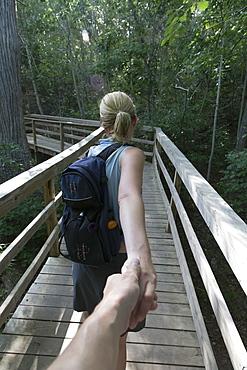 Mid-adult couple hiking, Texas