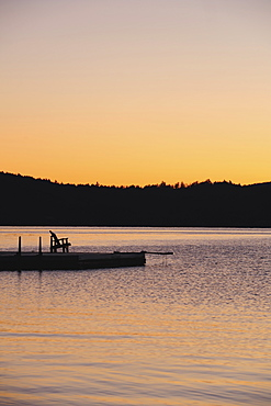 Jetty on lake at dawn, Lake George, New York
