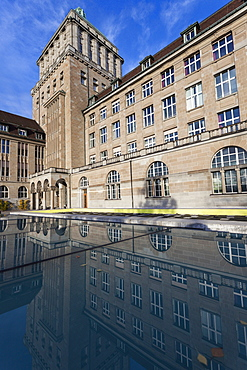 University of Zurich building reflecting in pond, University of Zurich, Zurich, Switzerland