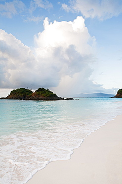 Scenic view of beach by sea, Trunk Bay, St. John, US Virgin Islands