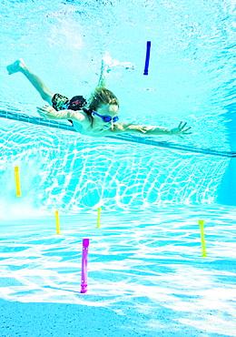 Boy (8-9) swimming in pool, Florida,USA