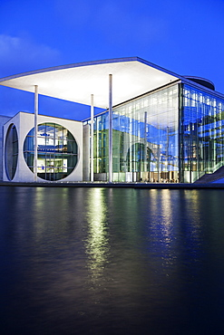 Riverfront parliament office building illuminated at dusk, Germany, Berlin, Federal Parliament Offices