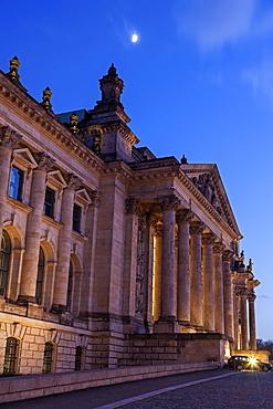Moon over Bundestag building at dusk, Germany, Berlin, Reichstag building