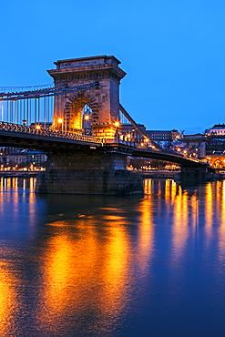 Illuminated Chain Bridge and reflections on water, Hungary, Budapest, Chain bridge