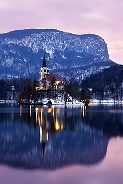 Lake Bled and illuminated Church of the Assumption, Slovenia, Bled