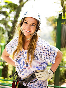 Portrait of smiling woman wearing helmet, Costa Rica