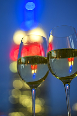 View of two wineglasses with white wine, USA, New York, New York City