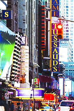 USA, New York, New York City, Times square, 42nd street, Neon lights and advertisements on street