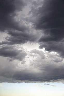 Storm clouds gathering on late evening sky