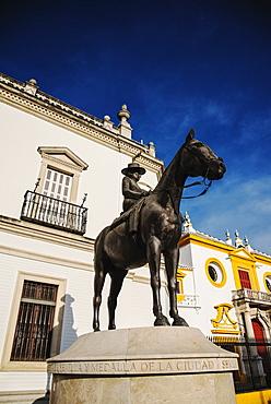 Spain, Seville, Equestrian statue of Augusta Senora Condesa de Barcelona in front of Plaza de Toros