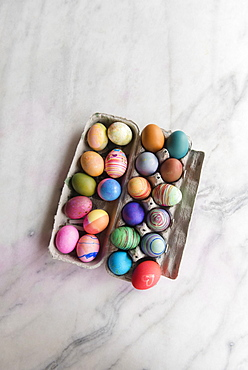 Dyed eggs in carton