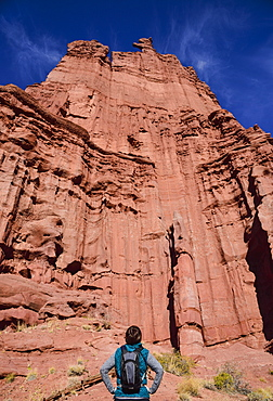 Woman standing by Fisher Towers in Utah, USA