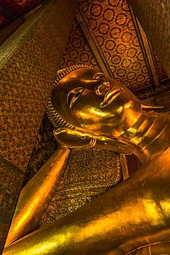 Gold statue of Buddha in Bangkok, Thailand