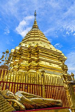 Statues of Buddha by wat in Bangkok, Thailand