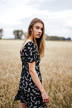 Young woman in wheat field