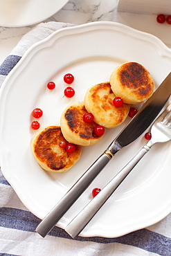 Syrniki with cranberries