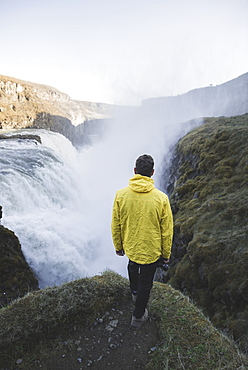 Hiker by Gullfoss waterfall in Iceland