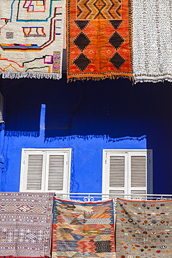 Rugs hanging from balconies in Marrakesh, Morocco