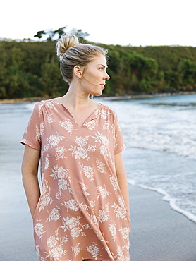 Woman in floral pattern dress at beach