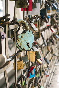 Padlocks on fence in Barcelona, Spain