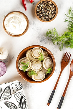 Dumplings in bowl with dill
