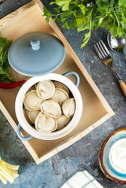 Pot of dumplings on tray