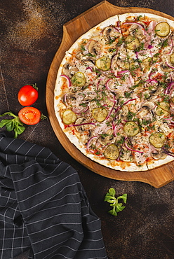 Pizza with pickles and red onion