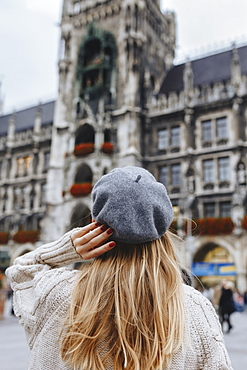 Woman wearing beret by New Town Hall in Munich, Germany