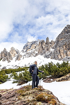 Woman hiking on Giau Pass in Dolomites, Passo Giau, Belluno, Italy