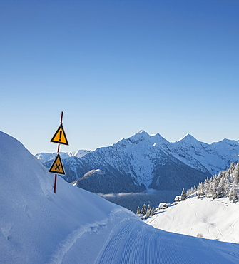 Warning signs on ski track in Piedmont, Italy