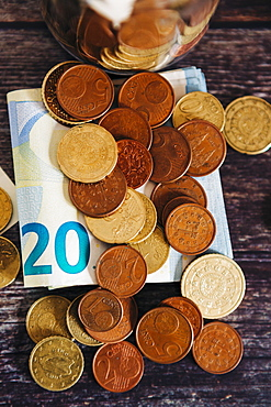Euro coins on twenty Euro note