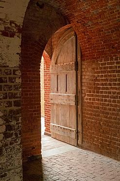 Open door and brick wall