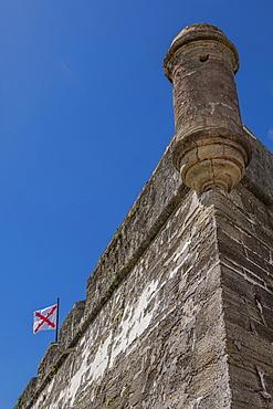Cross of Burgundy flag on Castillo de San Marcos in St. Augustine, USA