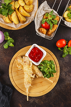 Deep fried food with tomato sauce