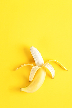 Banana on yellow surface