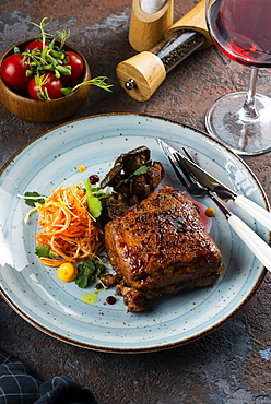 Grilled meat with salad by glass of red wine