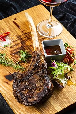 Rib steak on cutting board