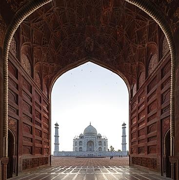 Taj Mahal behind arch in Agra, Uttar Pradesh, India