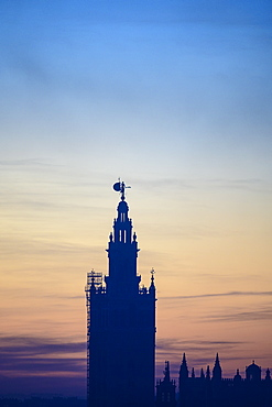 Silhouette of Giralda at sunrise in Seville, Andalusia, Spain