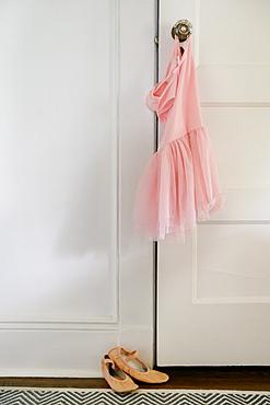 Pink ballet tutu hanging on doorknob
