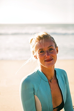 Portrait of woman wearing wetsuit at beach