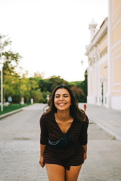 Smiling woman on footpath, Lisboa, Lisbon, Portugal