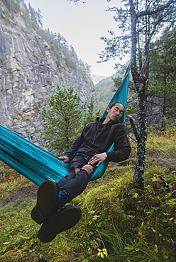 Young man resting in hammock